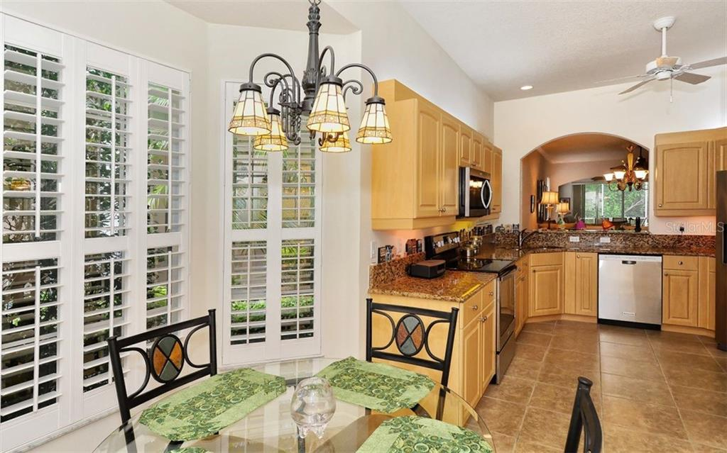Breakfast nook to kitchen - Villa for sale at 1647 Lancashire Dr #1647, Venice, FL 34293 - MLS Number is A4404210