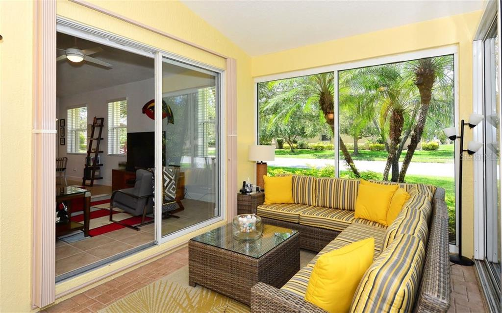 Florida room looking into the family room - Single Family Home for sale at 6507 42nd St E, Sarasota, FL 34243 - MLS Number is A4404611