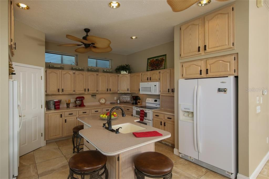 2 Refrigerators, Vegetable Sink, Eat at Island, Bay Views - Single Family Home for sale at 1778 Bayshore Dr, Englewood, FL 34223 - MLS Number is A4405962