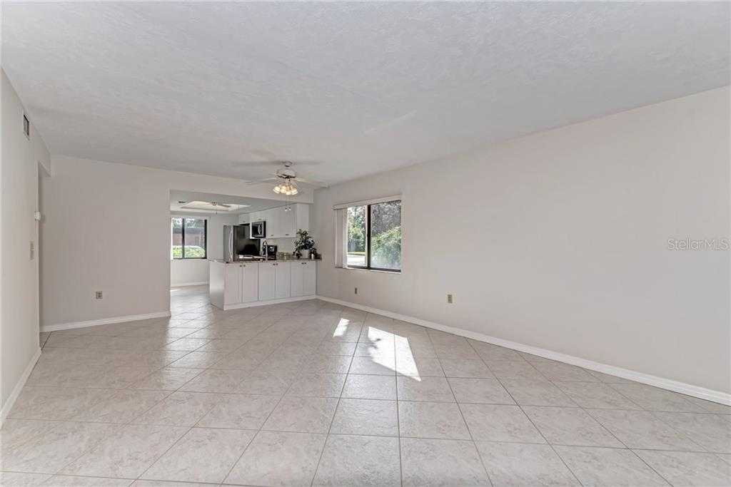 Rear elevation - Condo for sale at 7670 Eagle Creek Dr, Sarasota, FL 34243 - MLS Number is A4406667