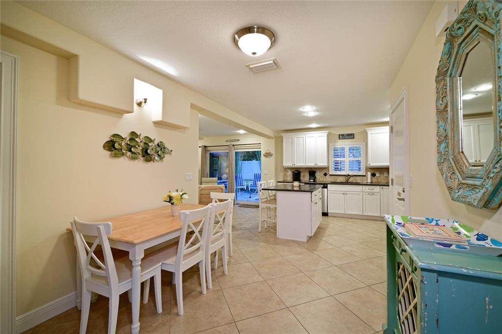 From dining area to kitchen. - Single Family Home for sale at 113 36th St, Holmes Beach, FL 34217 - MLS Number is A4407267