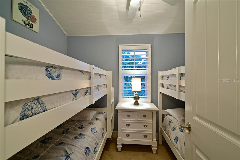 Bedroom number five is great for kids. - Single Family Home for sale at 113 36th St, Holmes Beach, FL 34217 - MLS Number is A4407267