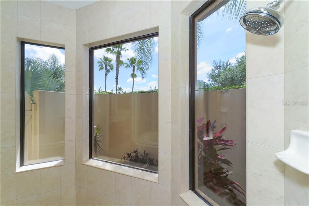 Large walk thru master shower overlooks an enclosed garden - Single Family Home for sale at 13219 Palmers Creek Ter, Lakewood Ranch, FL 34202 - MLS Number is A4407857
