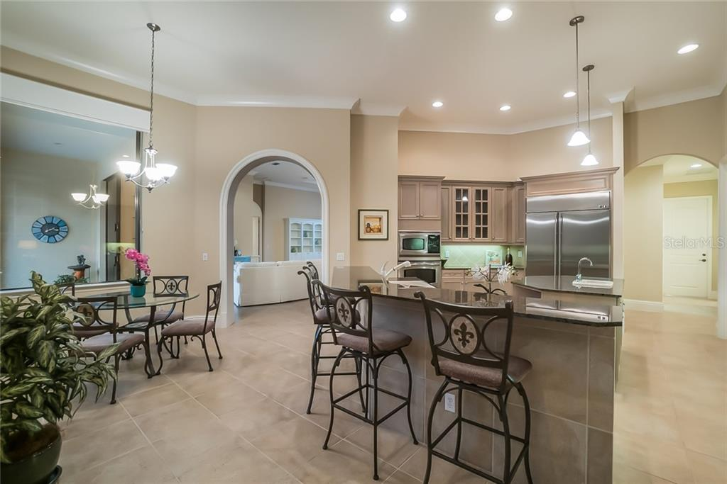 Dinette and Kitchen - Single Family Home for sale at 13223 Palmers Creek Ter, Lakewood Ranch, FL 34202 - MLS Number is A4408290