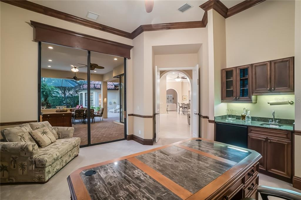 The Den/Office includes a wet bar with refrigerator and ice maker. Pocket sliding doors open to the Outdoor Kitchen. - Single Family Home for sale at 13223 Palmers Creek Ter, Lakewood Ranch, FL 34202 - MLS Number is A4408290