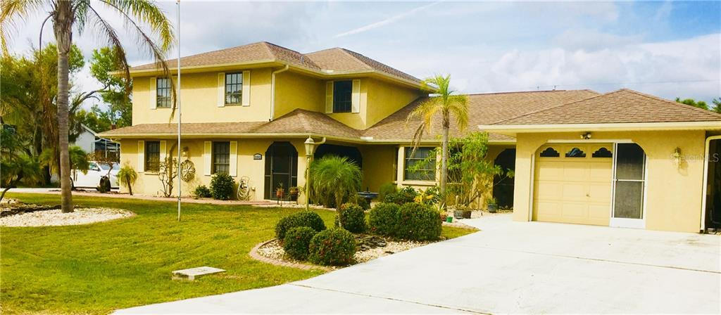 Single Family Home for sale at 23352 Abrade Ave, Port Charlotte, FL 33980 - MLS Number is A4409579
