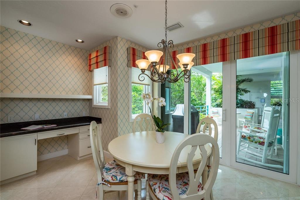 Wonderful dining area in kitchen with built-in desk and high-impact sliding glass doors to front terrace! - Condo for sale at 340 Gulf Of Mexico Dr #116, Longboat Key, FL 34228 - MLS Number is A4411000