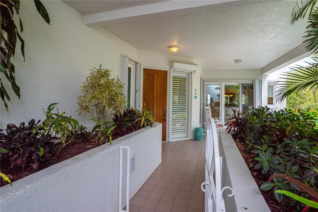 Private front terrace with community managed garden beds and natural gas connection for your outdoor BBQ! - Condo for sale at 340 Gulf Of Mexico Dr #116, Longboat Key, FL 34228 - MLS Number is A4411000