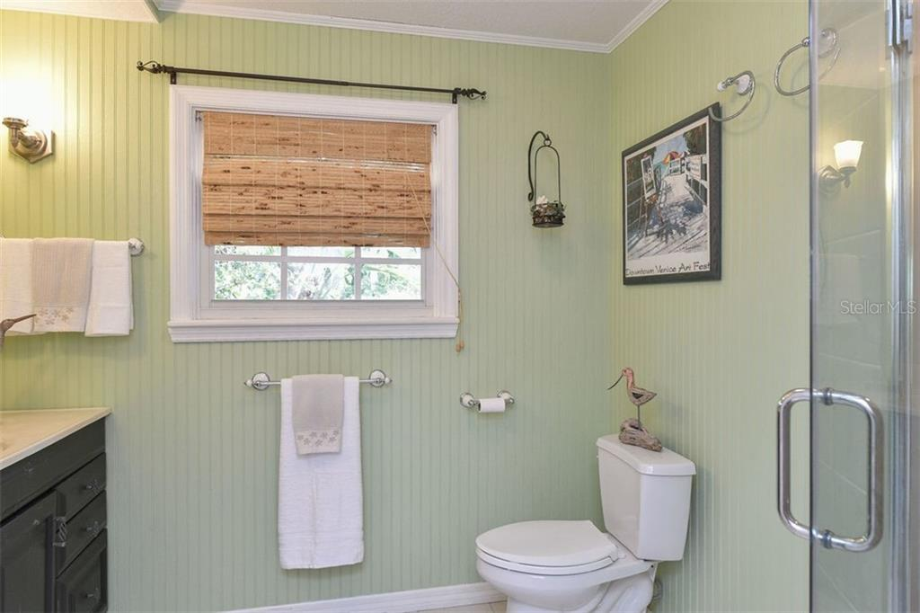 Main level bathroom, adjacent to 2nd bedroom, centrally located in home. - Single Family Home for sale at 417 Bayview Pkwy, Nokomis, FL 34275 - MLS Number is A4411087