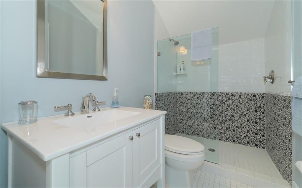 In-law suite bathroom - Single Family Home for sale at 138 Island Cir, Sarasota, FL 34242 - MLS Number is A4412265