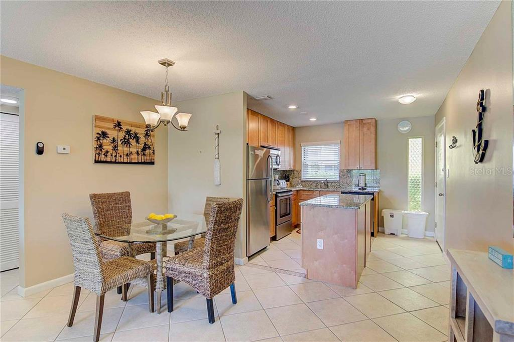 Dining Room to Kitchen - Condo for sale at 925 Beach Rd #107b, Sarasota, FL 34242 - MLS Number is A4413716