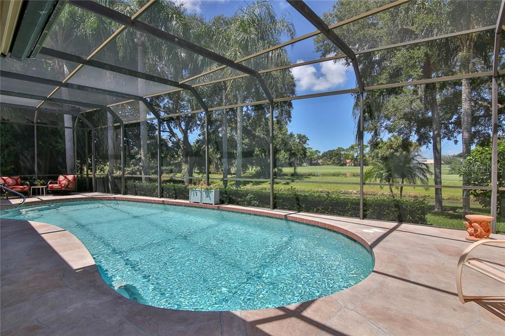 Beautiful water and creek views from the lanai. - Villa for sale at 7686 Calle Facil, Sarasota, FL 34238 - MLS Number is A4413755