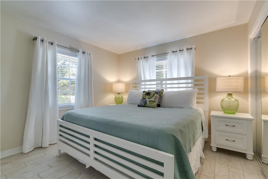 Buttonwood Master Bedroom. - Single Family Home for sale at 1101-1105 Point Of Rocks Rd, Sarasota, FL 34242 - MLS Number is A4415890