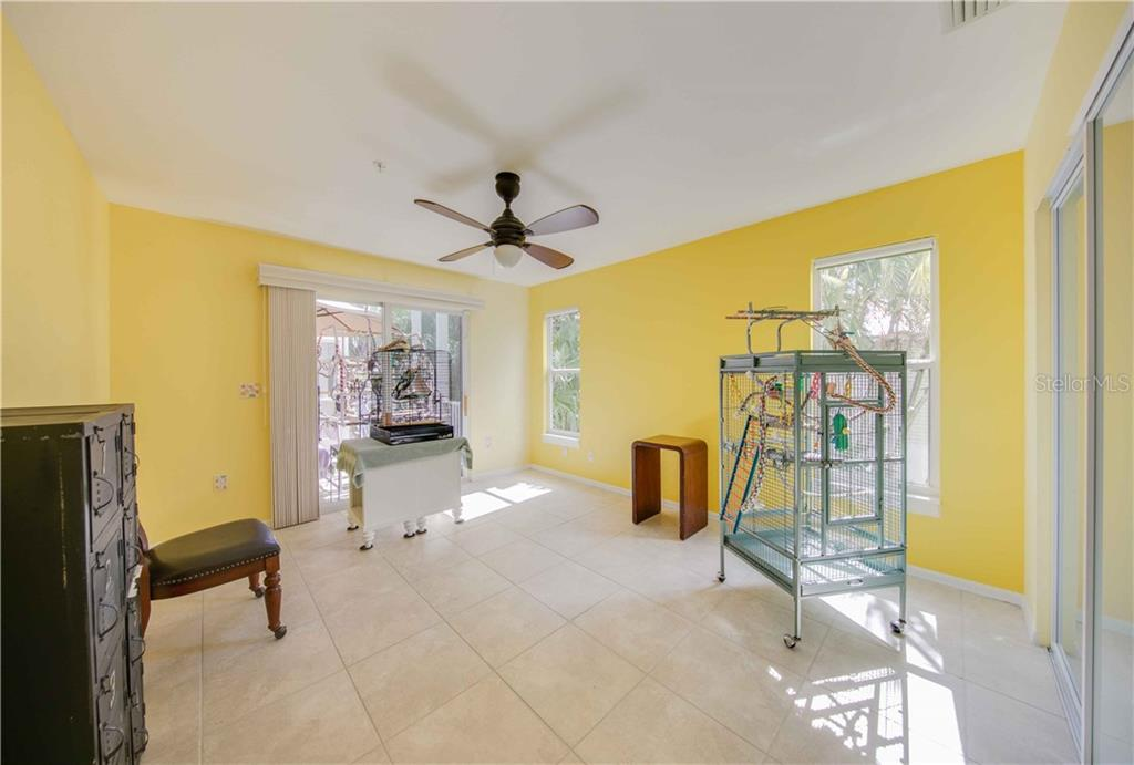 The 3rd bedroom is currently being used by the homeowner for the lucky birds. It opens through the sliders to the screened in deck. - Single Family Home for sale at 660 Marbury Ln, Longboat Key, FL 34228 - MLS Number is A4415911