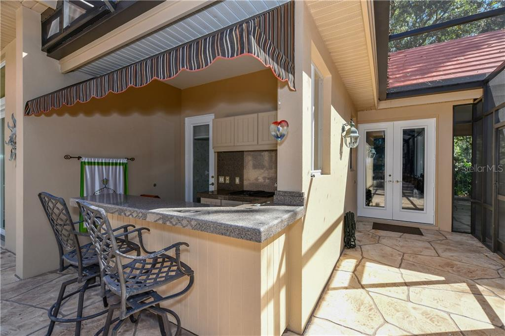 Summer Kitchen with Jenn Air Grill - Single Family Home for sale at 7659 Alister Mackenzie Dr, Sarasota, FL 34240 - MLS Number is A4416607