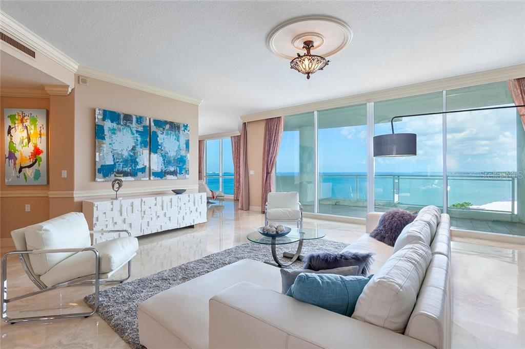Gorgeous Bayfront  living room - Condo for sale at 990 Blvd Of The Arts #1102, Sarasota, FL 34236 - MLS Number is A4417004