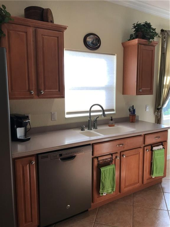 Corian sink with new faucet. - Villa for sale at 252 Fairway Isles Ln, Bradenton, FL 34212 - MLS Number is A4417217