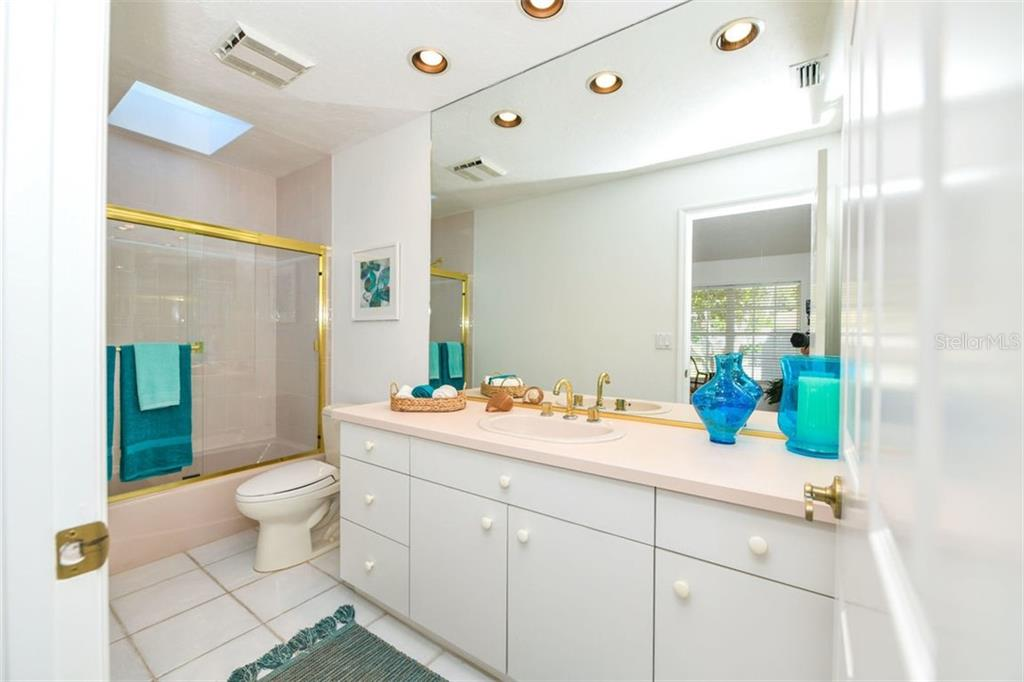 En suite bathroom - Single Family Home for sale at 7689 Cove Ter, Sarasota, FL 34231 - MLS Number is A4417242