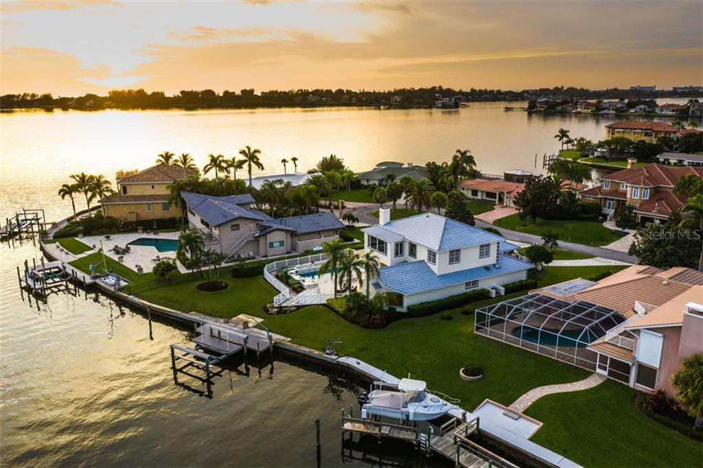 Year-round serene sunset views - Single Family Home for sale at 7689 Cove Ter, Sarasota, FL 34231 - MLS Number is A4417242