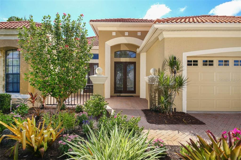 Gorgeous Courtyard Entrance - Single Family Home for sale at 7060 Whitemarsh Cir, Lakewood Ranch, FL 34202 - MLS Number is A4417363