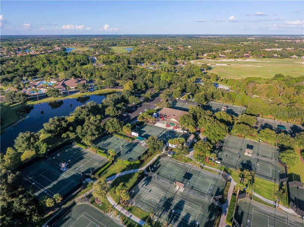 Lakewood Ranch Country Club 20 Har-Tru Tennis Courts, 18 Lighted - Single Family Home for sale at 7060 Whitemarsh Cir, Lakewood Ranch, FL 34202 - MLS Number is A4417363