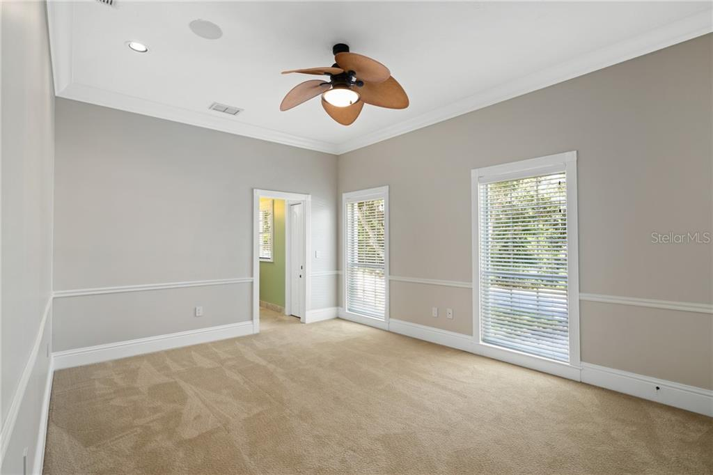 Guest Bedroom #4, with high ceilings, recessed Lutron lighting, large windows, Ensuite and a walk-in closet. - Single Family Home for sale at 1654 Landings Blvd, Sarasota, FL 34231 - MLS Number is A4417765