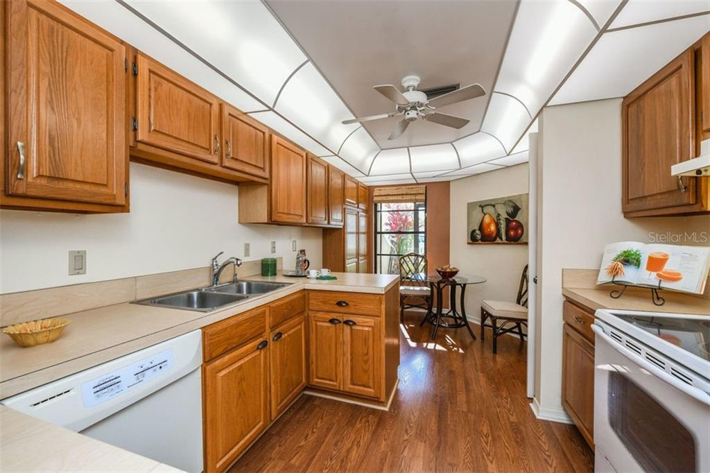 Light and bright kitchen with nice eating area and extra cabinets. - Villa for sale at 3617 Gleneagle Dr, Sarasota, FL 34238 - MLS Number is A4417832