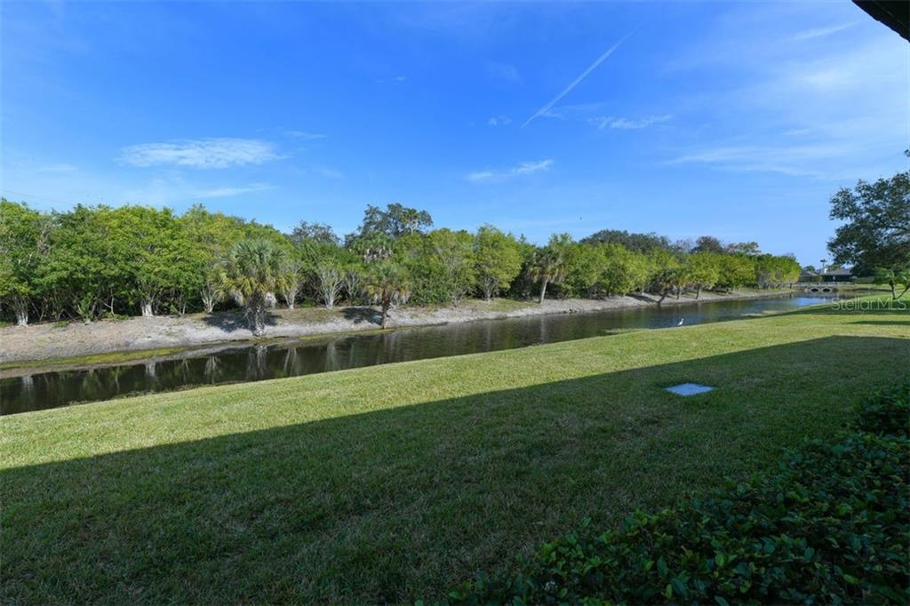 View out the back of the villa looking north down the waterway. Lots of wildlife to watch. - Villa for sale at 3617 Gleneagle Dr, Sarasota, FL 34238 - MLS Number is A4417832