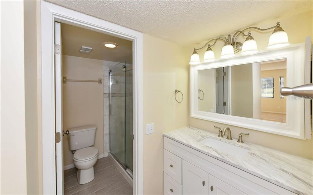 Updated Master Bathroom - Condo for sale at 4576 Longwater Chase #59, Sarasota, FL 34235 - MLS Number is A4418168