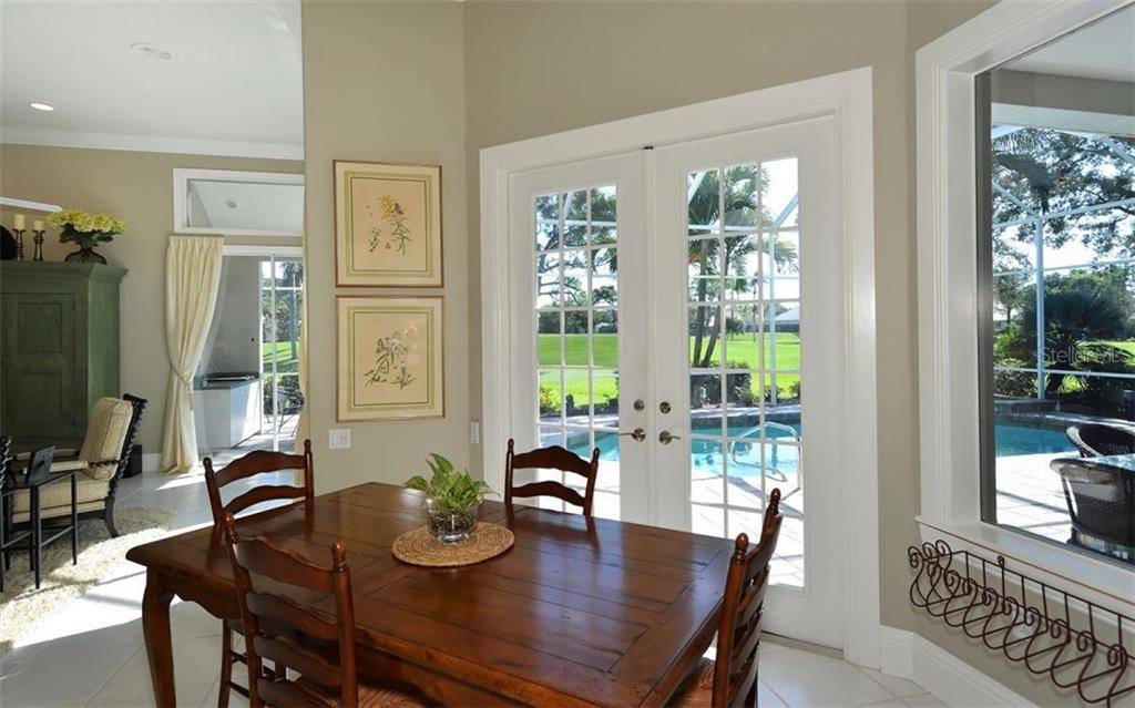 Breakfast nook with French door to lanai, pool - Single Family Home for sale at 462 Sherbrooke Ct, Venice, FL 34293 - MLS Number is A4418225