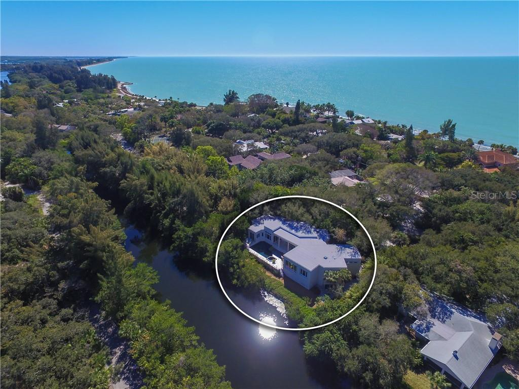 On almost an acre and over 450' on Heron Lagoon - Single Family Home for sale at 7259 Turnstone Rd, Sarasota, FL 34242 - MLS Number is A4418410