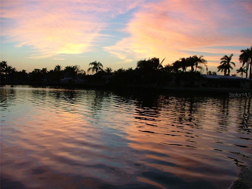 Sunset view from water terrace - Single Family Home for sale at 612 Ambassador Ln, Holmes Beach, FL 34217 - MLS Number is A4418766