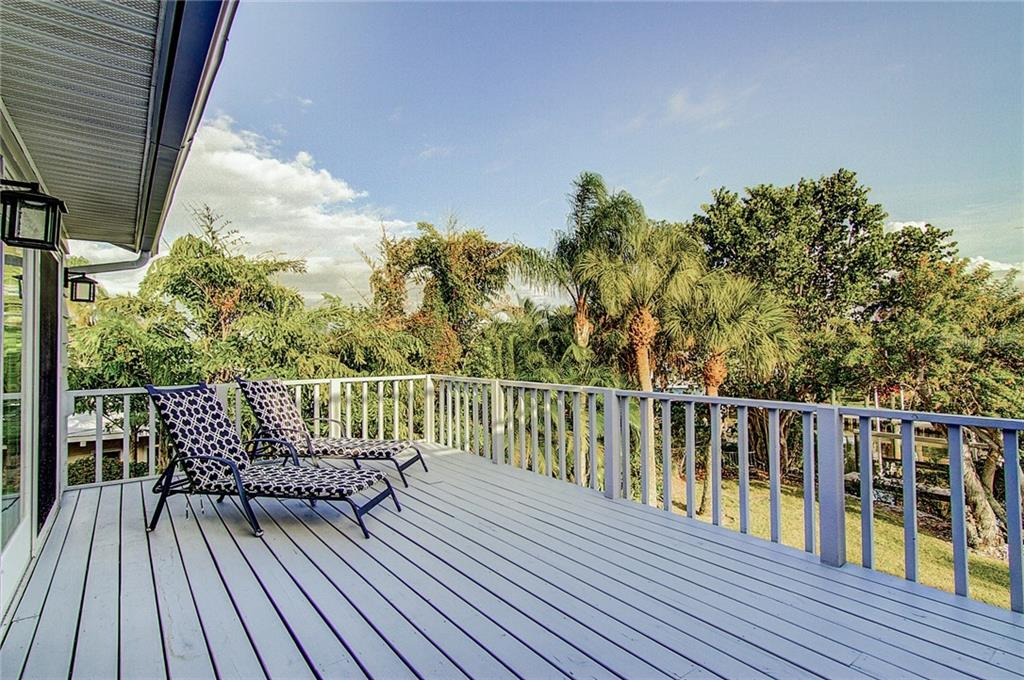The sun deck overlooks the huge backyard and canal - Single Family Home for sale at 521 75th St, Holmes Beach, FL 34217 - MLS Number is A4420243