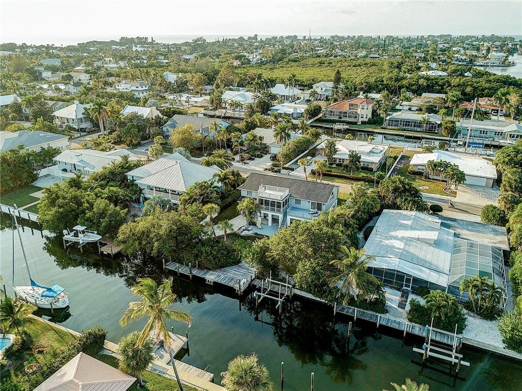 Located on the desirable 75th Street in Holmes Beach - Single Family Home for sale at 521 75th St, Holmes Beach, FL 34217 - MLS Number is A4420243