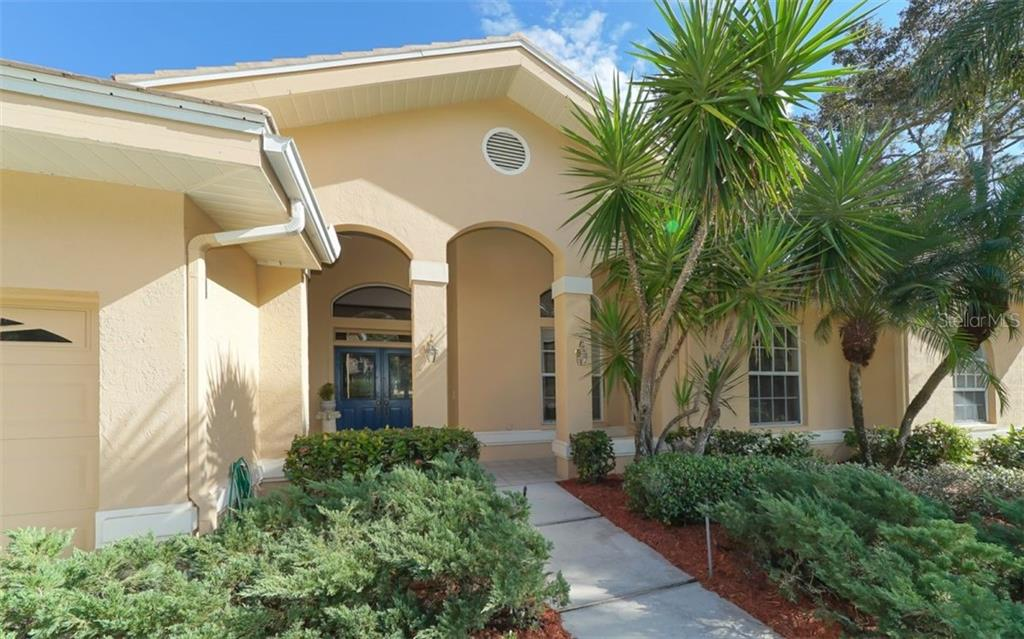 Double door entry with accented glass windows. - Single Family Home for sale at 6125 Varedo Ct, Sarasota, FL 34243 - MLS Number is A4420656