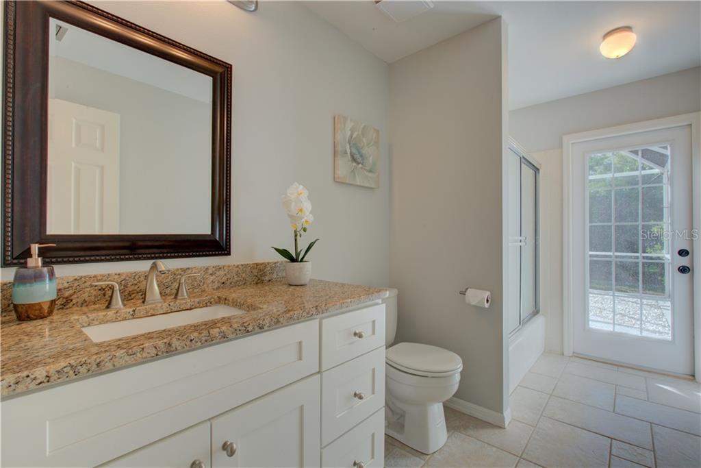 2nd bathroom with tub and shower and pool access - Single Family Home for sale at 5167 Kestral Park Ln, Sarasota, FL 34231 - MLS Number is A4421162