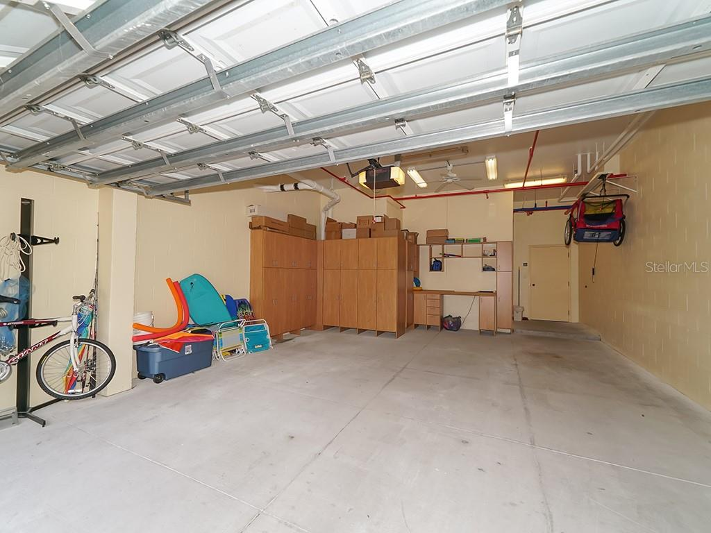 Private Spacious 2 Car Garage w/Built-ins & Workbench - Condo for sale at 2399 Gulf Of Mexico Dr #3c3, Longboat Key, FL 34228 - MLS Number is A4421722