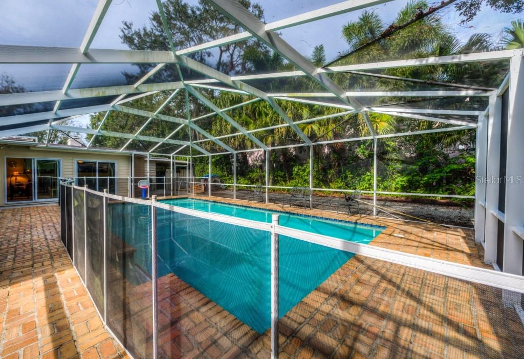 The easy care 29 x 46 brick pool deck gives you plenty of room to spread out and entertain family and friends, Florida living at its finest! - Single Family Home for sale at 1509 Flower Dr, Sarasota, FL 34239 - MLS Number is A4421898