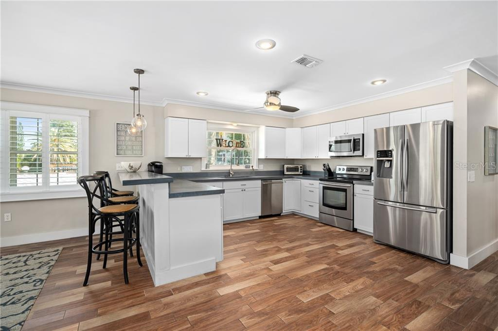 Second Floor Kitchen and Eat in Breakfast Bar - Single Family Home for sale at 107 Willow Ave, Anna Maria, FL 34216 - MLS Number is A4421946