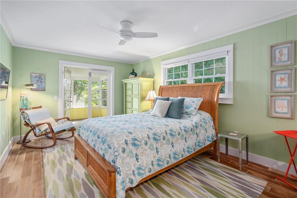 Second Floor Guest Bedroom 1 - Single Family Home for sale at 107 Willow Ave, Anna Maria, FL 34216 - MLS Number is A4421946