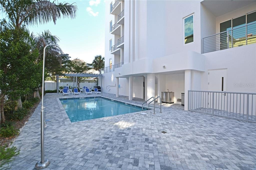 Elevator access to private foyer, open floor plan with 11 ft. ceilings & 3 terraces. - Condo for sale at 609 Golden Gate Pt #201, Sarasota, FL 34236 - MLS Number is A4422340