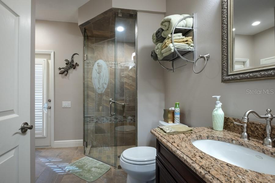 Pool Bathroom - Single Family Home for sale at 7791 Alister Mackenzie Dr, Sarasota, FL 34240 - MLS Number is A4422525