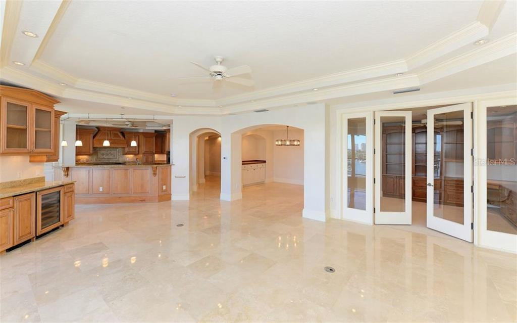Open Living Room, Study, Dining and Kitchen areas. - Condo for sale at 464 Golden Gate Pt #701, Sarasota, FL 34236 - MLS Number is A4422622