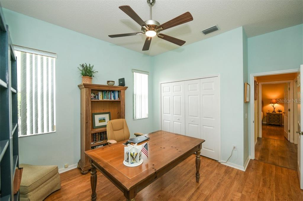 Second bedroom/study looking toward hall bath and 3rd bedroom - Single Family Home for sale at 6161 Varedo Ct, Sarasota, FL 34243 - MLS Number is A4422883