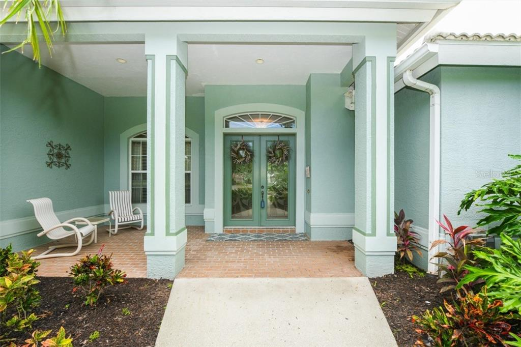 Entrance and front porch - Single Family Home for sale at 6161 Varedo Ct, Sarasota, FL 34243 - MLS Number is A4422883