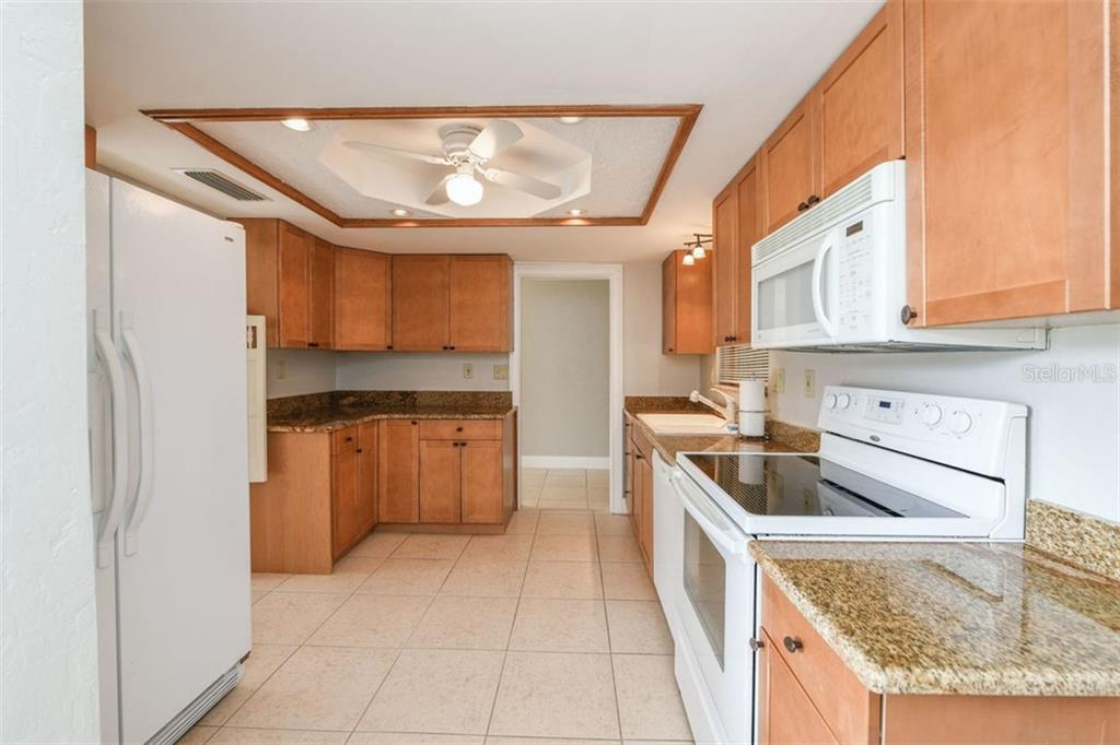 Kitchen. - Villa for sale at 3434 Medford Ln #1110, Sarasota, FL 34239 - MLS Number is A4422897