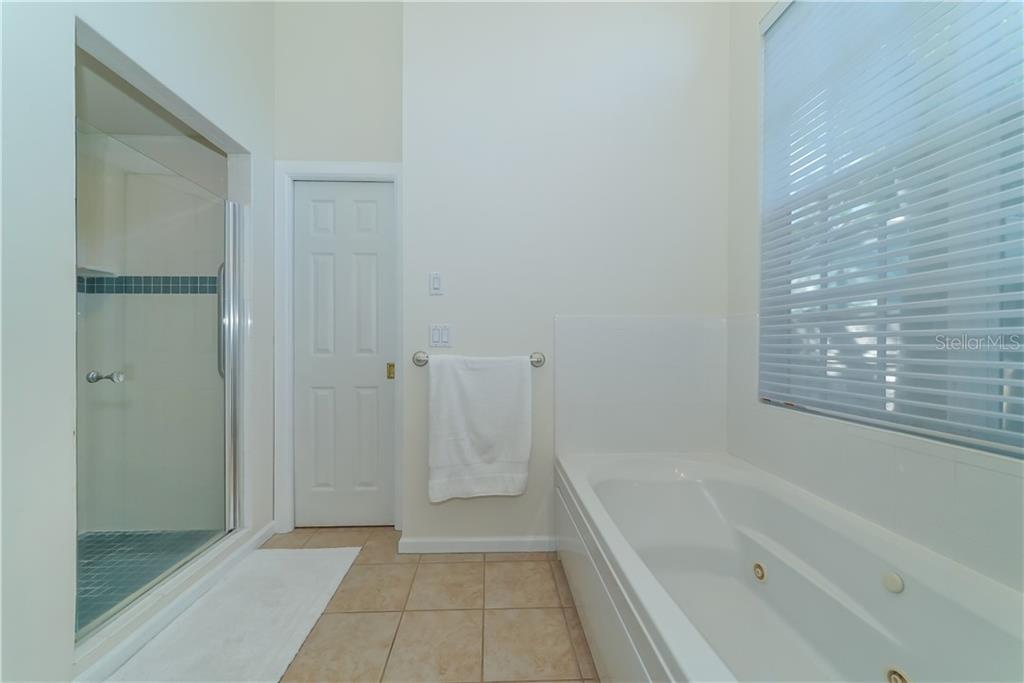 Large Jetted Tub and separate shower. Perfect after your morning workout! - Single Family Home for sale at 2300 Mietaw Dr, Sarasota, FL 34239 - MLS Number is A4423151