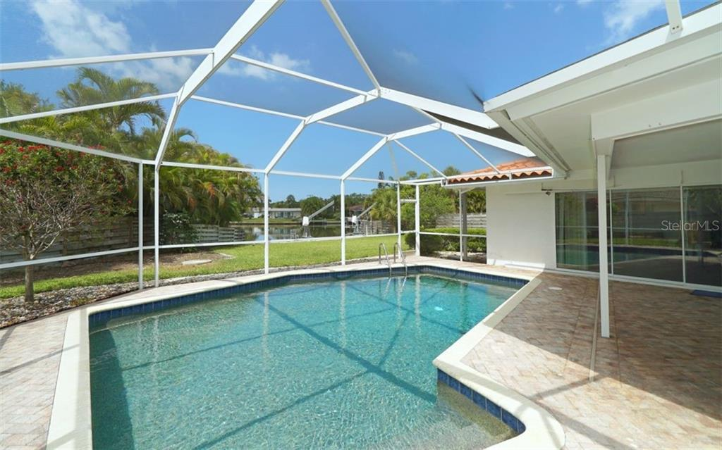 Single Family Home for sale at 5440 Azure Way, Sarasota, FL 34242 - MLS Number is A4423188