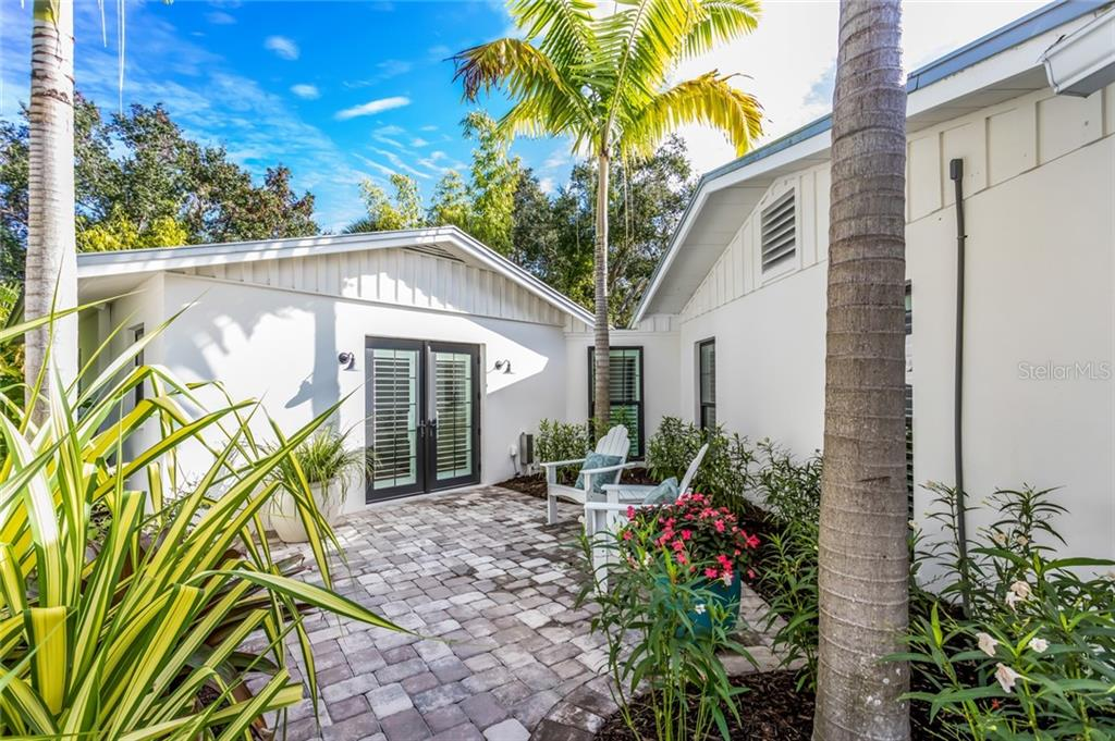 Private garden patio off the Suite bedrooms - Single Family Home for sale at 6957 Belgrave Dr, Sarasota, FL 34242 - MLS Number is A4423362