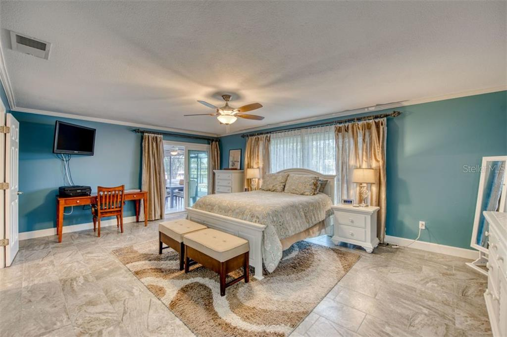 Master bedroom - slider to pool - Single Family Home for sale at 5548 Shadow Lawn Dr, Sarasota, FL 34242 - MLS Number is A4423461